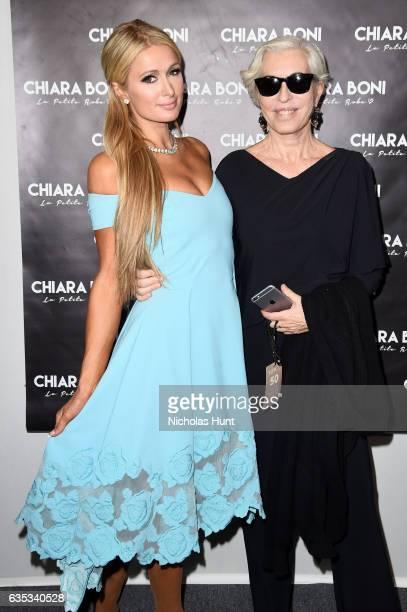 Paris Hilton and designer Chiara Boni pose backstage for the Chiara Boni La Petite Robe collection during New York Fashion Week The Shows at Gallery...