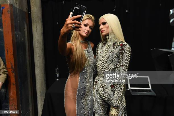 Paris Hilton and designer Phillipe Blond pose backstage for the The Blonds collection during New York Fashion Week The Shows at Gallery 1 Skylight...