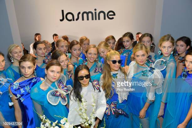 Paris Hilton and designer Qin pose with models and Model Megan Williams at the Jasmine fashion show during September 2018 New York Fashion Week The...