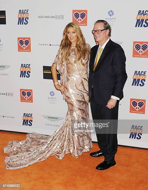 Paris Hilton and father Rick Hilton arrive at the 22nd Annual Race To Erase MS at the Hyatt Regency Century Plaza on April 24 2015 in Century City...