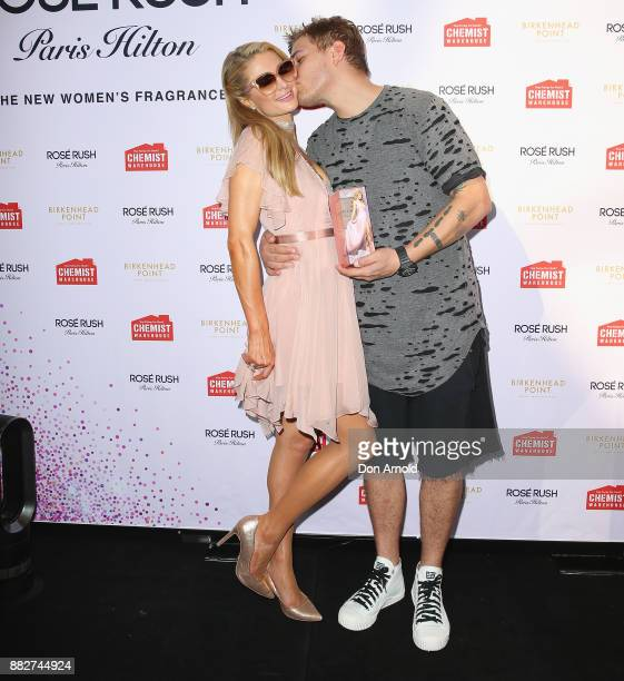 Paris Hilton and fiance Chris Zylka pose at the launch of her new fragrance Rose Rush on November 30 2017 in Sydney Australia