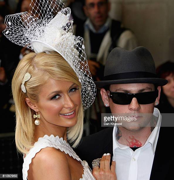 Paris Hilton and her boyfriend Benji Madden arrive at Selfridges department store on Oxford Street to launch her new fragrance 'Can Can' on May 15...