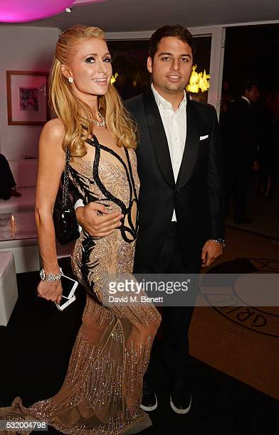 Paris Hilton and Jamie Reuben attend the de Grisogono party during the 69th Cannes Film Festival at Hotel du CapEdenRoc on May 17 2016 in Cap...