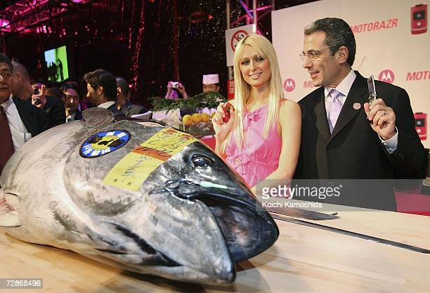 Paris Hilton and Motorola's corporate vicepresident and general manager Michael Tatelman pose in front of a big tuna fish during a mobile phone event...