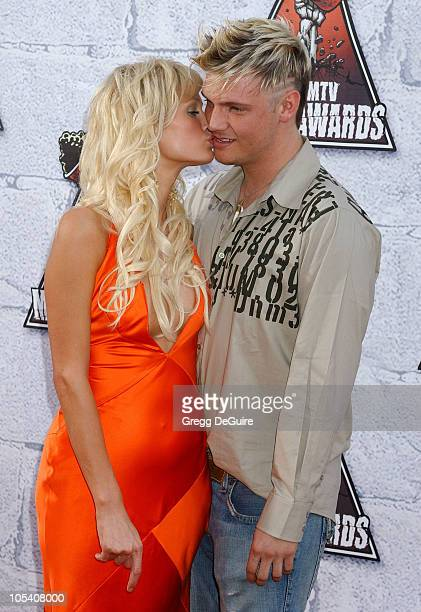 Paris Hilton and Nick Carter during MTV Movie Awards 2004 Arrivals at Sony Pictures Studios in Culver City California United States