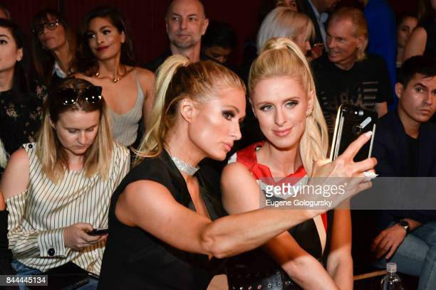 Paris Hilton and Nicki Hilton attend the Monse fashion show during New York Fashion Week The Shows on September 8 2017 in New York City