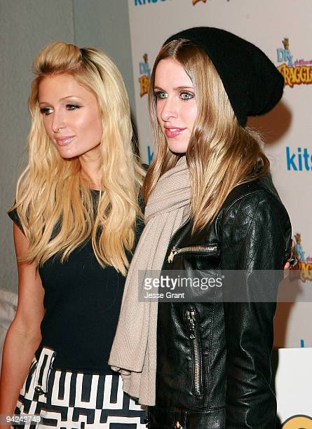 Paris Hilton and Nicky Hilton arrive at The Jim Henson Company's Fraggle Rock Holiday Toy Drive Benefit at Kitson on Roberston on December 9 2009 in...