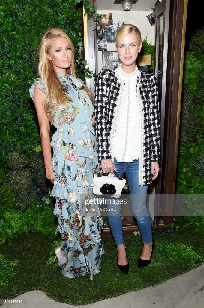 Paris Hilton and Nicky Hilton attend Alice + Olivia By Stacey Bendet - fashion show during September 2017 - New York Fashion Week: The Shows at Gallery 2, Skylight Clarkson Sq on September 12, 2017 in New York City.