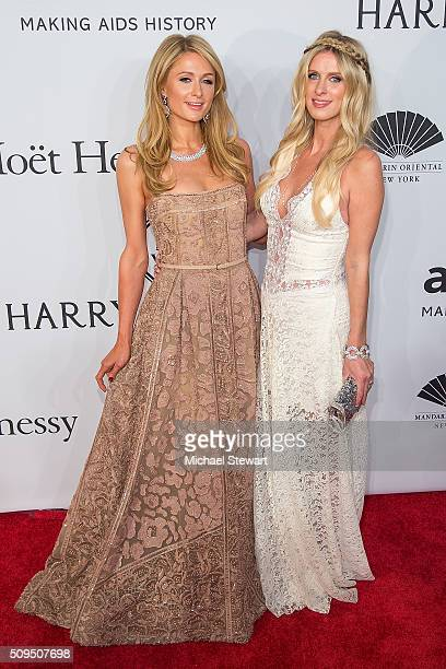 Paris Hilton and Nicky Hilton attend the 2016 amfAR New York Gala at Cipriani Wall Street on February 10 2016 in New York City