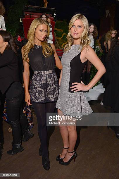 Paris Hilton and Nicky Hilton attend the alice olivia by Stacey Bendet Fall 2014 presentation during MercedesBenz Fashion Week Fall 2014 at The...