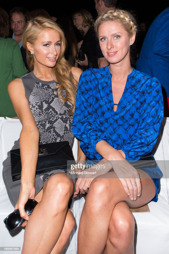 Paris Hilton (L) and Nicky Hilton attend the Diane Von Furstenberg show during Spring 2014 Mercedes-Benz Fashion Week at The Theatre at Lincoln Center on September 8, 2013 in New York City.