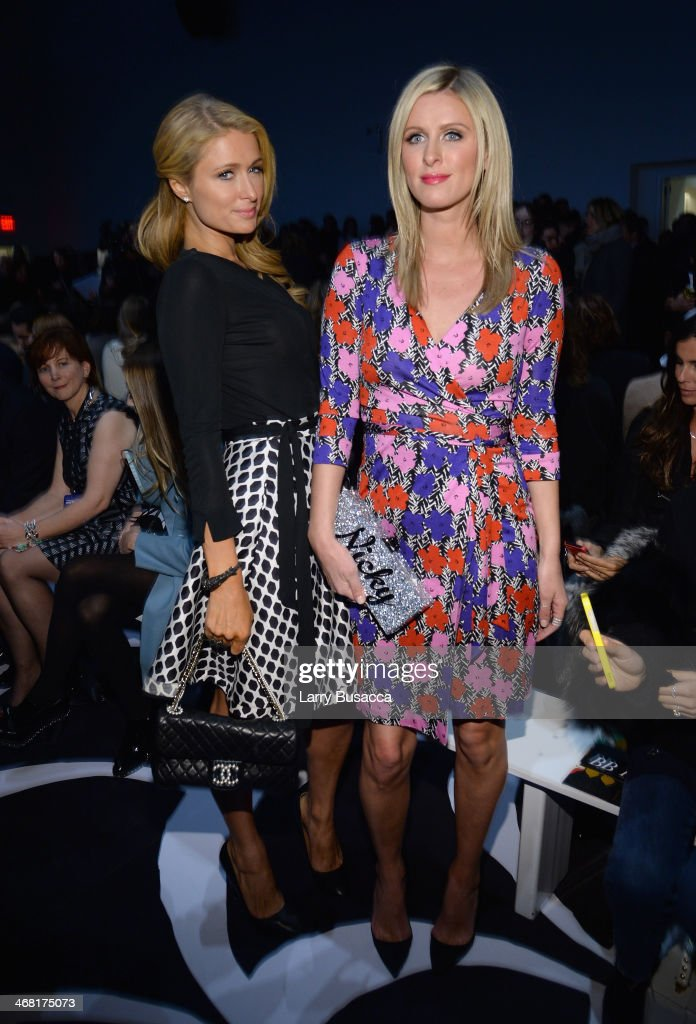 Paris Hilton and Nicky Hilton attend the Diane Von Furstenberg fashion show during Mercedes-Benz Fashion Week Fall 2014 at Spring Studios on February 9, 2014 in New York City.