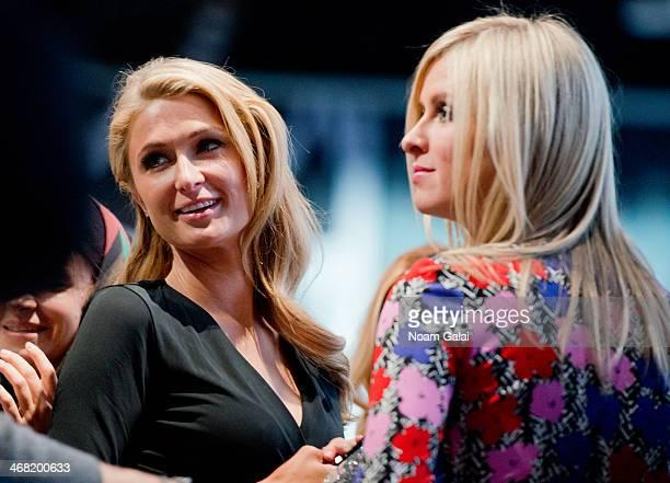 Paris Hilton and Nicky Hilton attend the Diane Von Furstenberg show during MercedesBenz Fashion Week Fall 2014 at Spring Studios on February 9 2014...