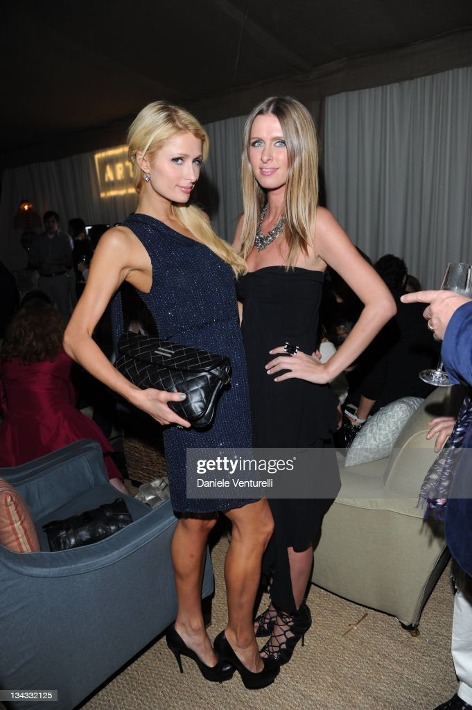 Paris Hilton and Nicky Hilton attends the 'Carter Cleveland, Wendi Murdoch And Dasha Zhukova Host Party' at Soho Beach House on November 30, 2011 in Miami Beach, Florida.