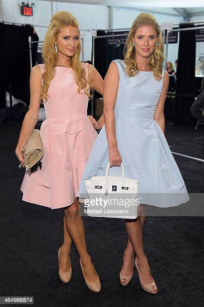 Paris Hilton and Nicky Hilton backstage at the Dennis Basso fashion show during MercedesBenz Fashion Week Spring 2015 at The Theatre at Lincoln...