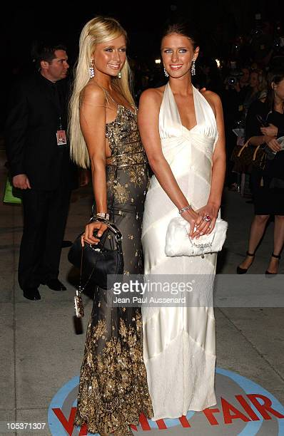 Paris Hilton and Nicky Hilton during 2004 Vanity Fair Oscar Party - Arrivals at Mortons in Beverly Hills, California, United States.