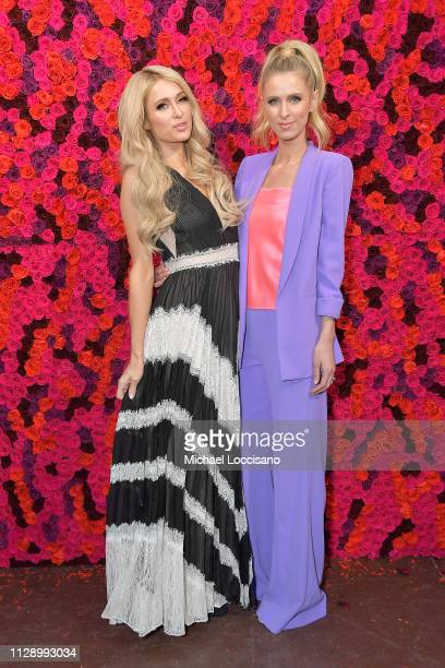 Paris Hilton and Nicky Hilton Rothschild attend the Alice Olivia By Stacey Bendet presentation during New York Fashion Week at The Angel Orensanz...