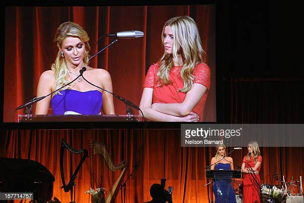 Paris Hilton and Nicky Hilton speak during the European School Of Economics Foundation Vision And Reality Awards on December 5 2012 in New York City