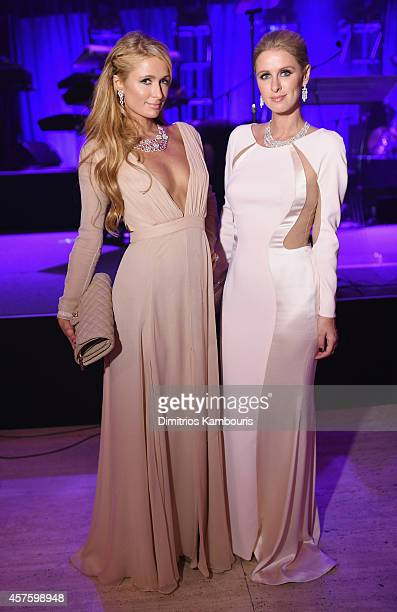 Paris Hilton and Nicky Hilton wearing Avakian attend Angel Ball 2014 hosted by Gabrielle's Angel Foundation at Cipriani Wall Street on October 20...