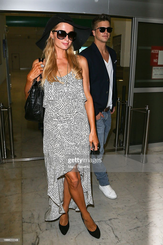 Paris Hilton and Riper Viperii arrive at Nice airport during the 66th annual Cannes Film Festival on May 15, 2013 in Nice, France.