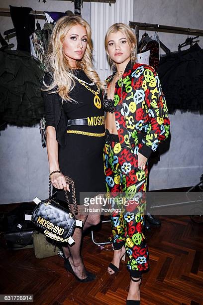 Paris Hilton and Sofia Richie are seen backstage ahead of the Moschino show during Milan Men's Fashion Week Fall/Winter 2017/18 on January 14 2017 in...