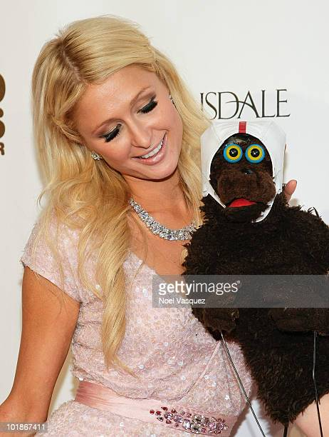 """Paris Hilton and Warren Demontague attend the launch party for MTV's """"The Hard Times Of RJ Berger"""" and """"Warren The Ape"""" on June 7, 2010 in West..."""