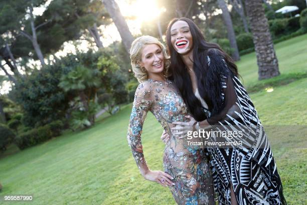 Paris Hilton and Winnie Harlow attend the cocktail at the amfAR Gala Cannes 2018 at Hotel du CapEdenRoc on May 17 2018 in Cap d'Antibes France