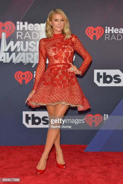 Paris Hilton arrives at the 2018 iHeartRadio Music Awards which broadcasted live on TBS TNT and truTV at The Forum on March 11 2018 in Inglewood...