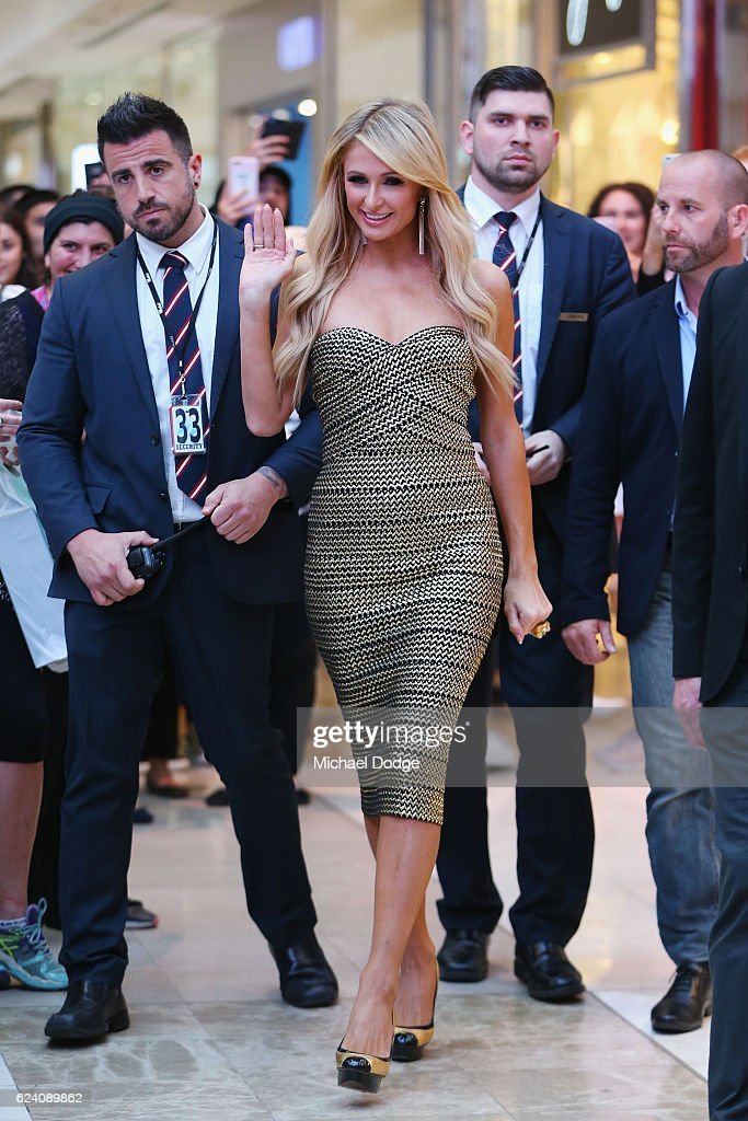 Paris Hilton arrives with bodyguards for a Q&A with fans at Westfield Doncaster on November 18, 2016 in Melbourne, Australia.