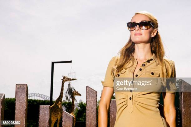 Paris Hilton backdropped by giraffes during a promotion visit to Australia to launch her 23rd fragrance Rosé Rush at Taronga Zoo on December 1 2017...