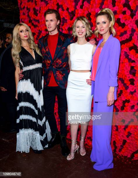 Paris Hilton, Barron Hilton II, Tessa Grafin von Walderdorff Hilton and Nicky Hilton Rothschild pose at the Alice & Olivia by Stacey Bendet FW19...