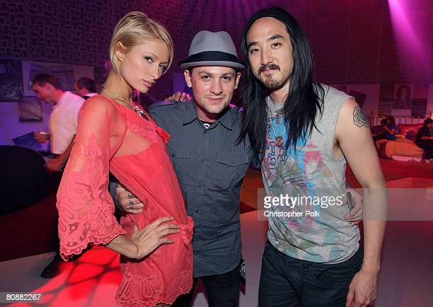 COACHELLA VALLEY CA APRIL 26 Paris Hilton Benji Madden and Steve Aoki at the TMobile Sidekick ToneDef After Party at a private airport hanger in...