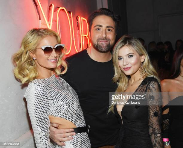 Paris Hilton Bert Marcus and Lola Tosh attend the 2018 Tribeca Film Festival World Premiere of Bert Marcus' THE AMERICAN MEME on April 27 2018 at...