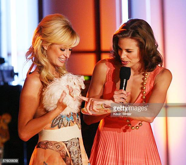 Paris Hilton Brooke Burns auction a puppy at the 13th Annual Race to Erase MS Disco Fever at the Century Plaza Hotel on May 12 2006 in Los Angeles...