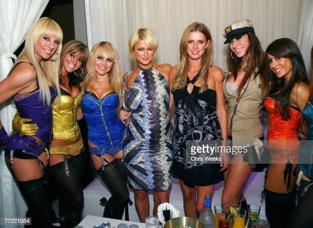 LAS VEGAS NEVADA OCTOBER 06 Paris Hilton center left Nicky Hilton center right and members of the Las Vegas Pussycat Dolls attend an evening hosted...