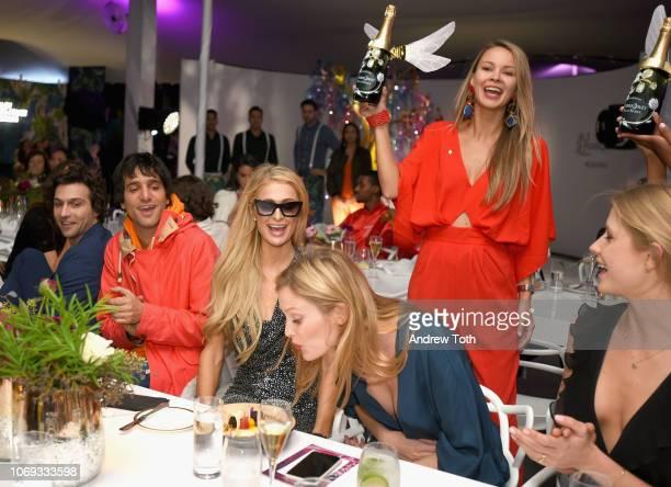 Paris Hilton Charlott Cordes and Kimberley Mens attend L'Eden by PerrierJouët on December 6 2018 in Miami Beach Florida
