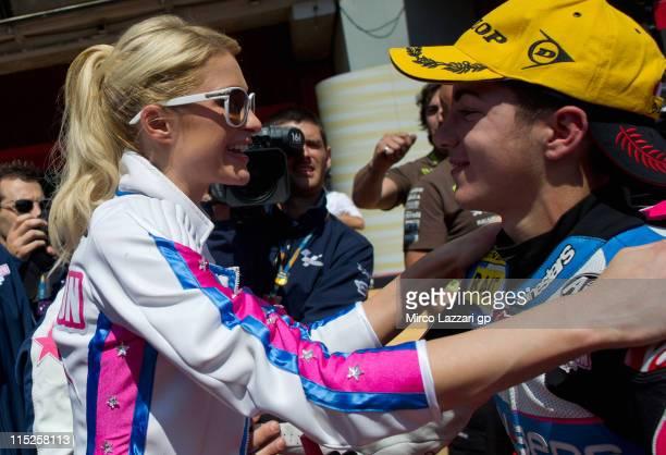 Paris Hilton congratulates her rider Maverick Vinales of Spain and PEVBlusensSMXParis Hilton under the podium of 125 cc race of MotoGP of Catalunya...