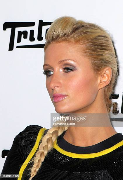 Paris Hilton displays a design by Triton during the first day of Sao Paulo Fashion Week Fall 2011 at Ibirapuera's Bienal Pavilion on January 28 2011...