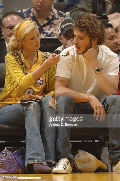 Paris Hilton feeds Stavros Niarchos III some food as the Los Angeles Lakers play against the Phoenix Suns on April 16 2006 at Staples Center in Los...