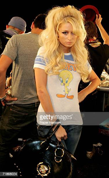Paris Hilton gets ready backstage at the Heatherette Spring 2007 fashion show during Olympus Fashion Week at the Tent in Bryant Park September 12...