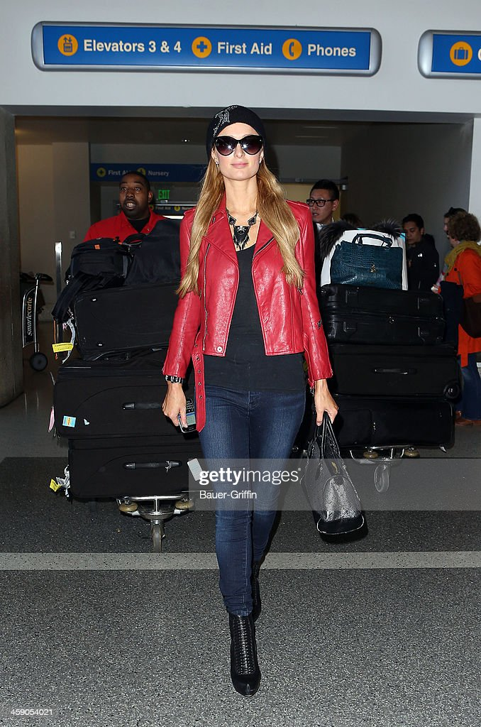 Paris Hilton is seen at Los Angeles International Airport on December 22, 2013 in Los Angeles, California.
