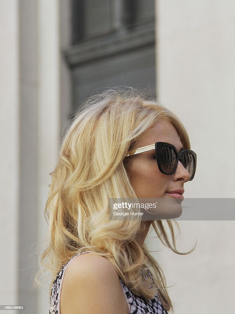 Paris Hilton is seen on the streets of Manhattan outside of the Dennis Basso Spring 2016 fashion show at Skylight at Moynihan Station wearing prom style dress and sunglasses on September 15, 2015 in New York City.