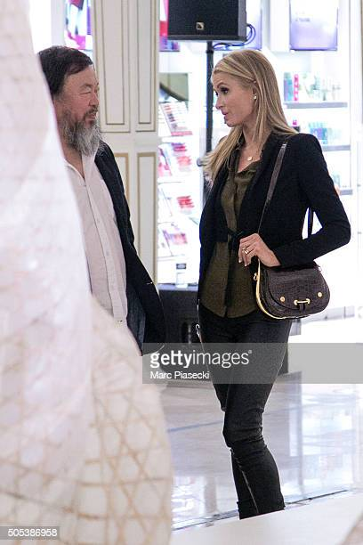 Paris Hilton is seen with artist Ai Wei Wei as they visit the 'Ai Wei Wei Er Xi' exhibition at Le Bon Marche department store on January 17 2016 in...