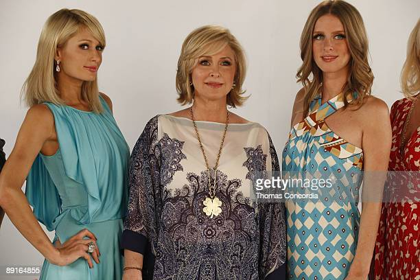 Paris Hilton, Kathy Hilton and Nikki Hilton pose on set during the taping of a commercial for Kathy Hilton's new makeup line on June 12, 2009 in...