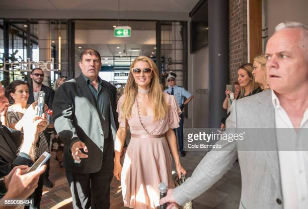 Paris Hilton makes her way through crowds of fans during a promotion visit to Australia to launch her 23rd fragrance Rosé Rush on November 30 2017 in...