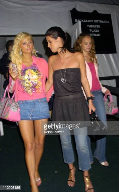 Paris Hilton Nicky Hilton and Bijou Phillips during Olympus Fashion Week Spring 2005 Tommy Hilfiger Backstage at Theatre Tent Bryant Park in New York...
