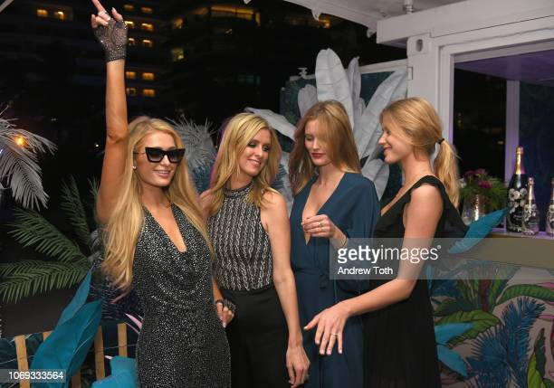 Paris Hilton Nicky Hilton Rothschild Charlott Cordes and Kimberley Mens attend L'Eden by PerrierJouët on December 6 2018 in Miami Beach Florida