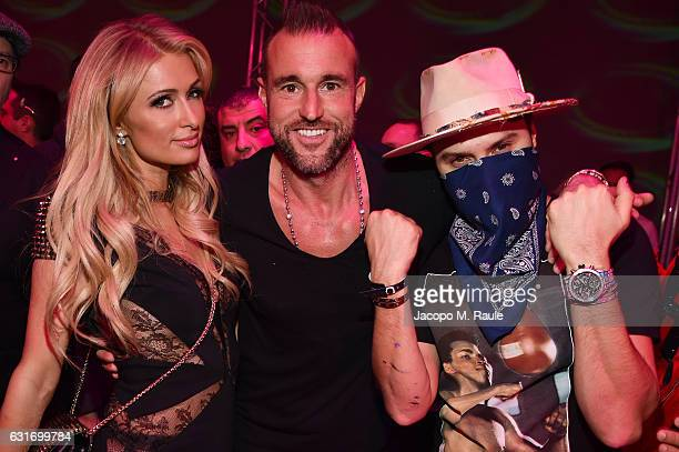 Paris Hilton Philipp Plein and Alec Monopoly attend the Plein Sport party during Milan Men's Fashion Week Fall/Winter 2017/18 on January 14 2017 in...