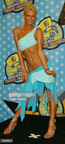 Paris Hilton poses backstage at The 2003 MTV Movie Awards held at the Shrine Auditorium on May 31, 2003 in Los Angeles, California.