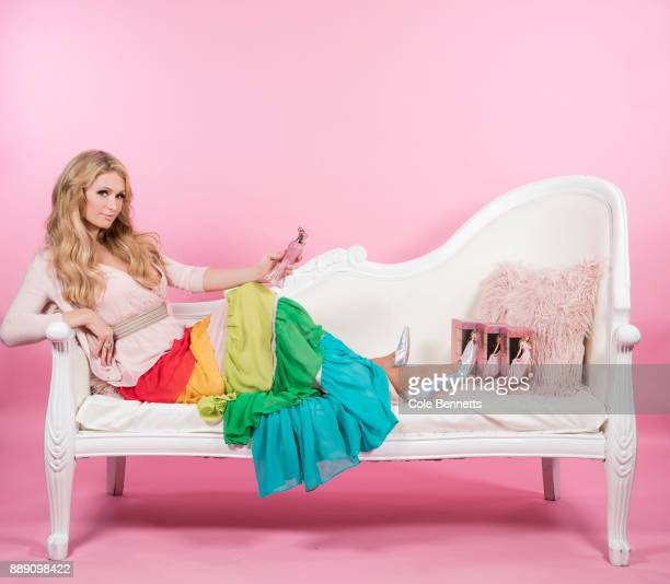 Paris Hilton poses for a photograph at the MTV studios during a promotion visit to Australia to launch her 23rd fragrance Rosé Rush on November 29...